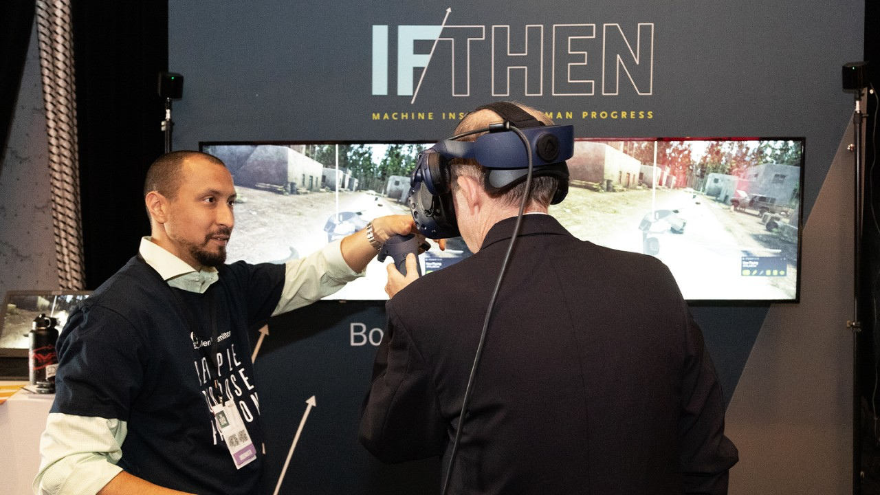 A man wearing a VR headset in front of a screen at the Atlantic Festival